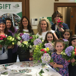 HGSS community making flower bouquets for GIFT recipients for Shavuot