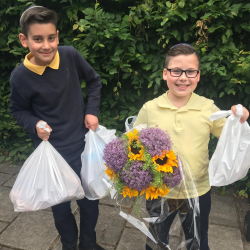 Volunteers delivering food parcels and flowers for Shavuot